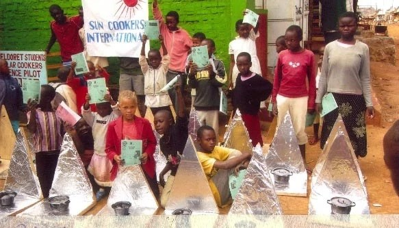Students display their solar cooker prototypes