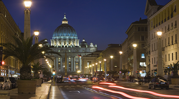 St. Peter's Basilica illuminated at night with moving traffic, Vatican City, Rome, Lazio, Italy, Europe