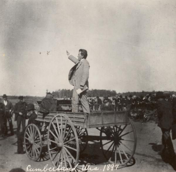 Fightin Bob La Follette speaking to Wisconsin citizens from a wagon.  From the Wisconsin Historical Society.