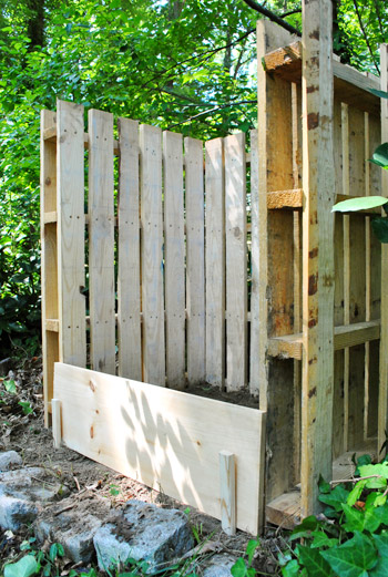 homemade compost bin made from pallets