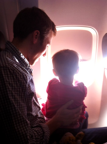 flying with toddler looking out the window