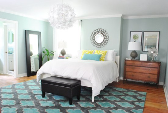 Bedroom Design Turquoise and Grey Area Rug in Pale Blue Room with White Chandelier and Hardwood Flooring