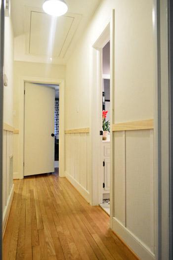progress on DIY board & batten project with vertical battens installed in hallway