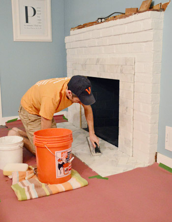 fireplace makeover tiling the mantel