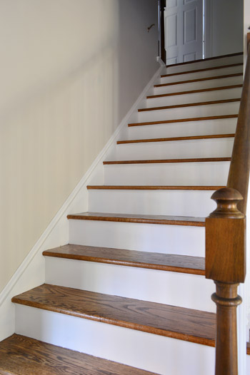 Stair Riser Painted White On Wooden Staircase