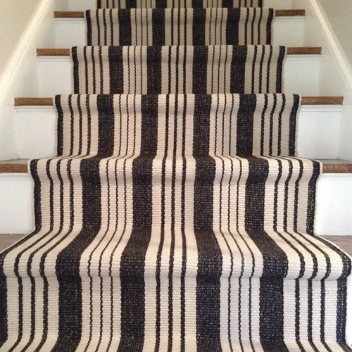 detail picture of finished stair runner installation to show hidden seam