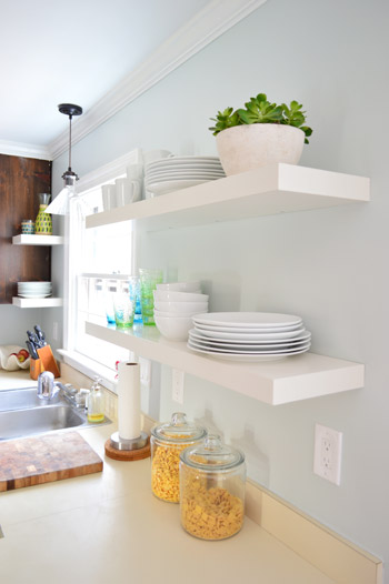 Great Two Pairs Of White Ikea LACK Shelves Hung In The Kitchen With White Plates,  Bowls