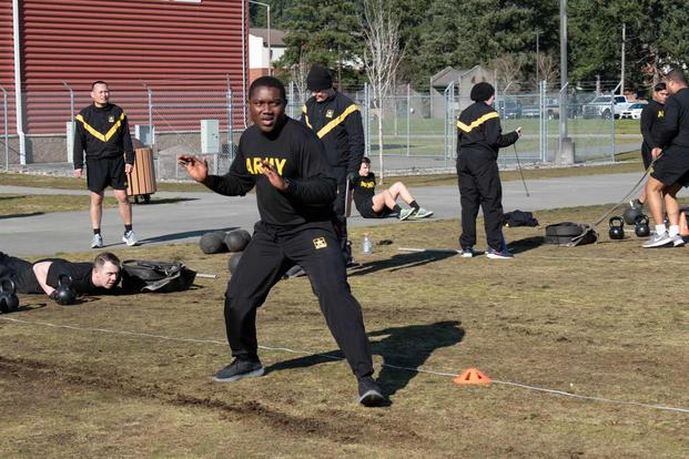 Soldiers execute the sprint-drag-carry portion of the ACFT.