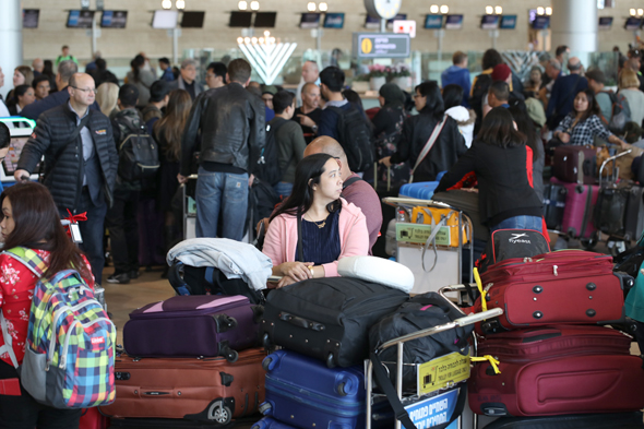 People waiting at Tel Aviv airport during the strike. Photo: Aner Green
