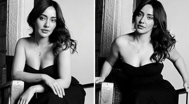 neha sharma looks hot and bold in black dress see viral photos