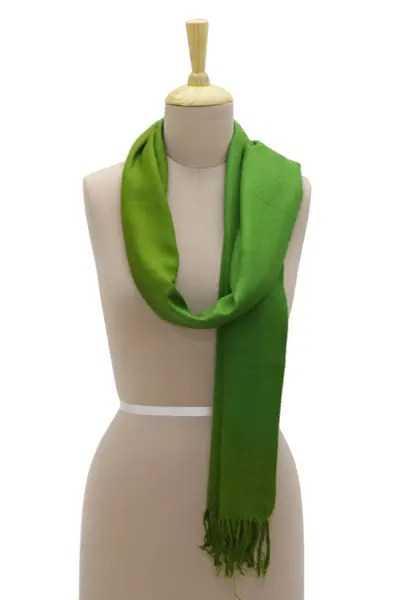 A cashmere travel wrap coloured green, a pretty and useful travel gift.