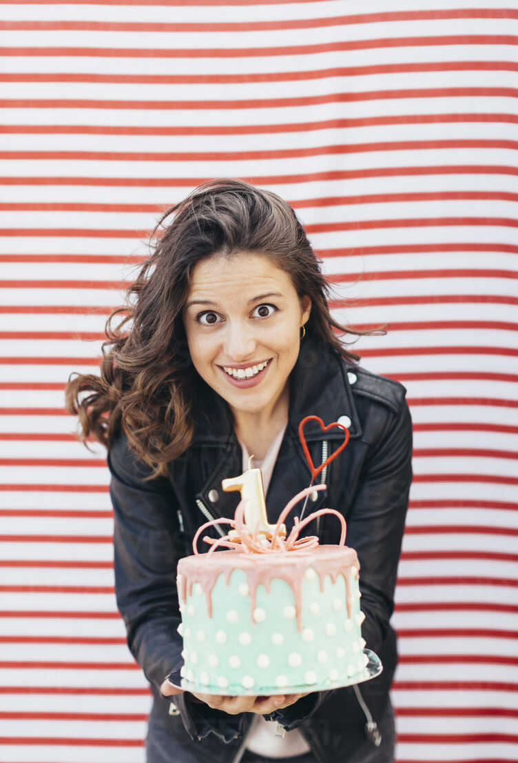 Portrait Of Woman With Birthday Cake Stockphoto