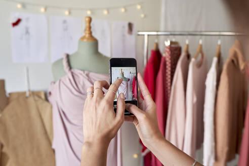 female fashion designer measuring