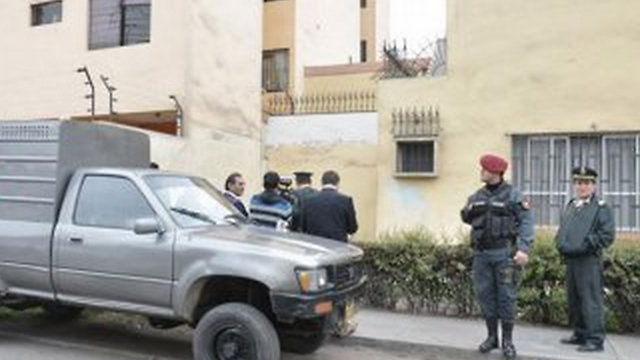 Peru security forces outside Muhammad Amadar's apartment.