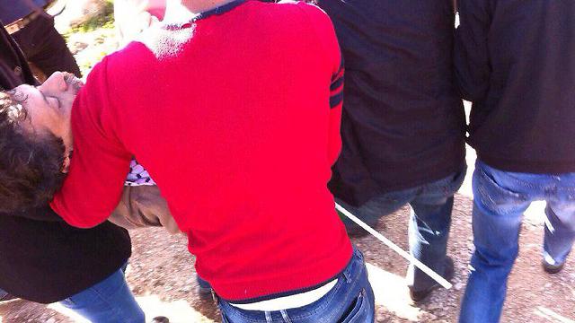 Abu Ein taken to hospital (Photo: Reut Mor)