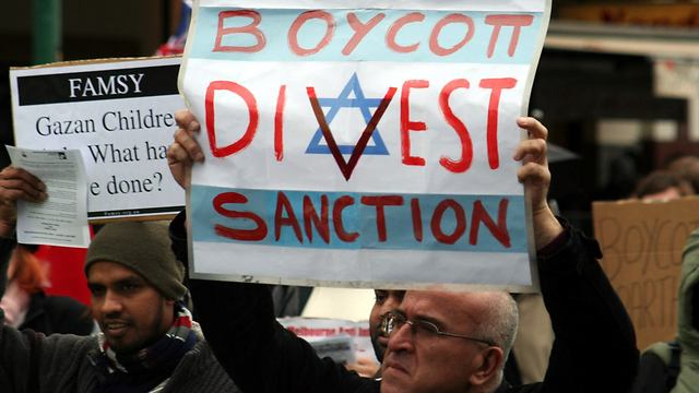 BDS supporter at a protest (Photo: Reuters)