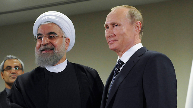 Putin with Iranian President Hassan Rouhani. Photo: AP