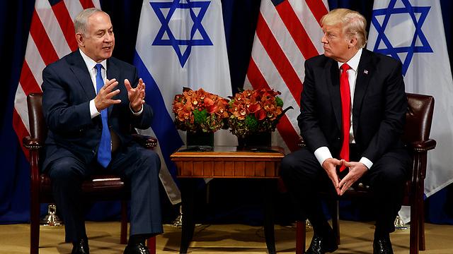 PM Netanyahu (L) and President Trump spoke often before the latter's speech (Photo: AP)