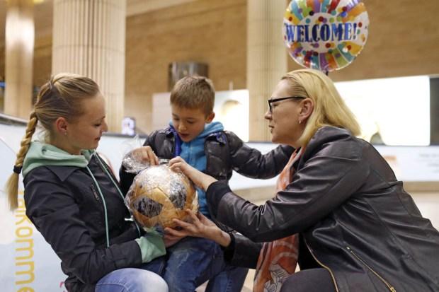 Юлия Малиновская с Еленой и Матвеем. Фото: Амит Шааль