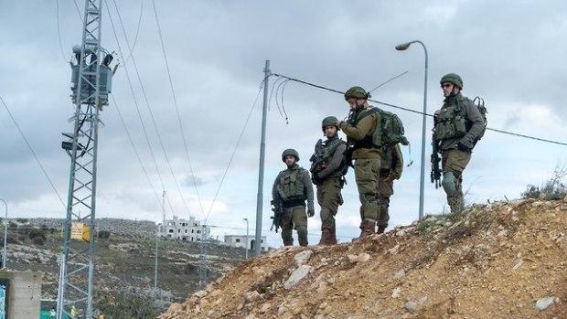 """Военнослужащие бригады """"Биньямин"""" на месте теракта. Фото: пресс-служба ЦАХАЛа"""