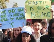 Manifestazione ambientalista a Doha (Afp)