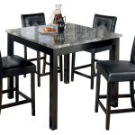 Signature Design By Ashley Maysville Counter Height Dining Room Table And Bar Stools Set Of 5