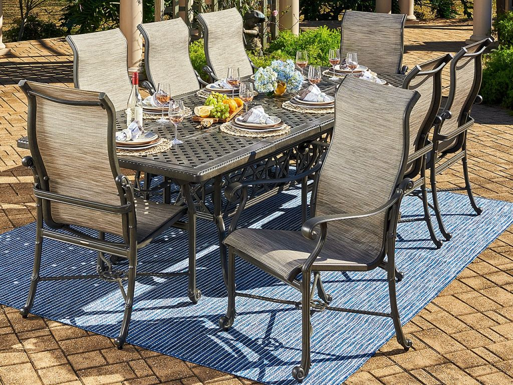 florence shade cast aluminum and watercolor tweed sling 9 pc dining set with 74 114 x 44 in double extension table