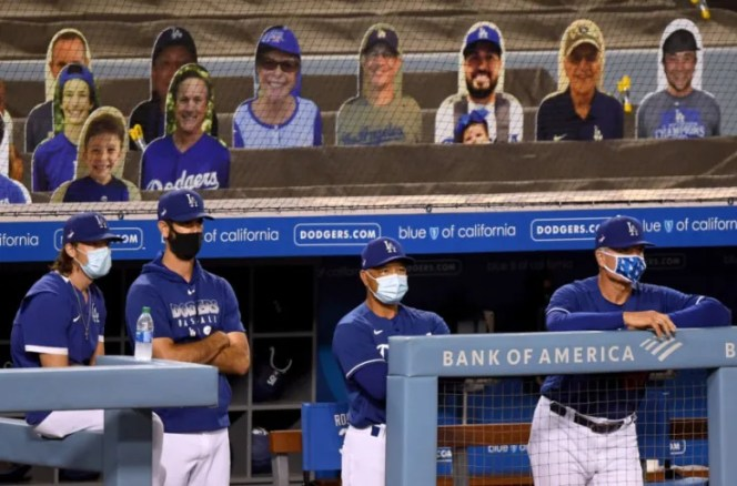 Dodgers coach pulling down mask to cough causes social media unrest