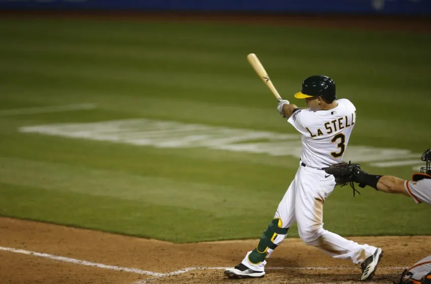 OAKLAND, CA - SEPTEMBER 18: Tommy La Stella #3 of the Oakland Athletics bats during the game against the San Francisco Giants at RingCentral Coliseum on September 18, 2020 in Oakland, California. The Athletics defeated the Giants 6-0. (Photo by Michael Zagaris/Oakland Athletics/Getty Images)