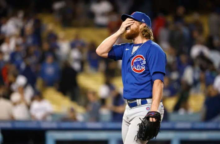 LOS ANGELES, CALIFORNIA - JUNE 24: Craig Kimbrel #46 of the Chicago Cubs reacts after throwing a combined no hitter against the Los Angeles Dodgers following the ninth inning at Dodger Stadium on June 24, 2021 in Los Angeles, California. The Chicago Cubs won, 4-0. (Photo by Michael Owens/Getty Images)