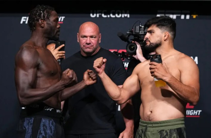 LAS VEGAS, NEVADA - AUGUST 20: In this UFC handout, (L-R) Opponents Jared Cannonier and Kelvin Gastelum face off during the UFC Fight Night weigh-in at UFC APEX on August 20, 2021 in Las Vegas, Nevada. (Photo by Chris Unger/Zuffa LLC via Getty Images)