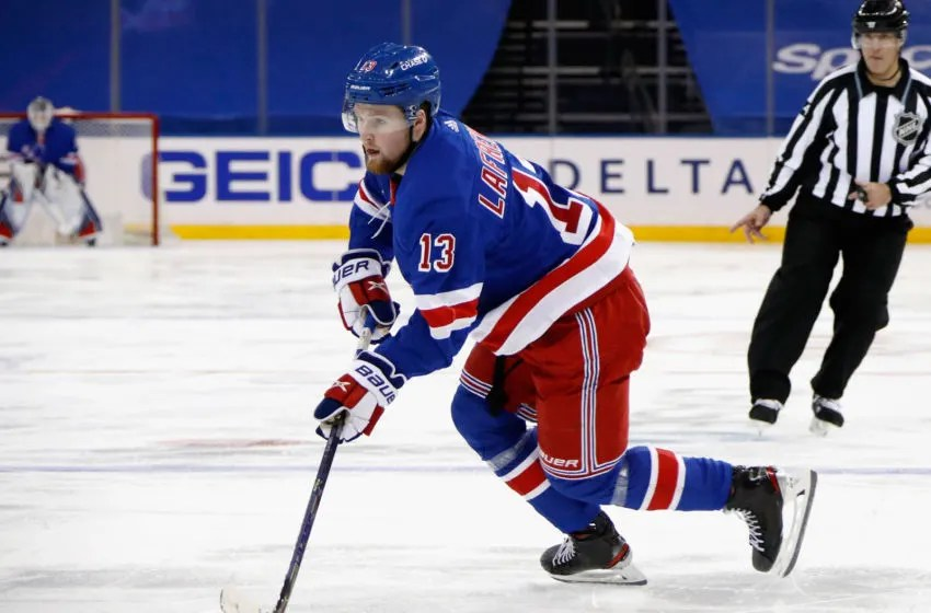 Jan 16, 2021; New York, New York, USA; New York Rangers left wing Alexis Lafreniere (13) skates against the New York Islanders during the second period at Madison Square Garden. Mandatory Credit: Bruce Bennett /POOL PHOTOS-USA TODAY Sports