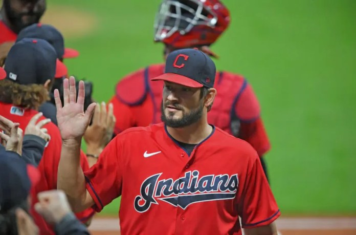 CLEVELAND, OHIO - SEPTEMBER 21: Brad Hand #33 of the Cleveland Indians celebrates after the Indians defeated the Chicago White Sox at Progressive Field on September 21, 2020 in Cleveland, Ohio. The Indians defeated the White Sox 6-4. (Photo by Jason Miller/Getty Images)