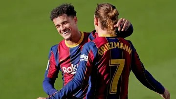 Griezmann and Coutinho hugging in a match against Osasuna