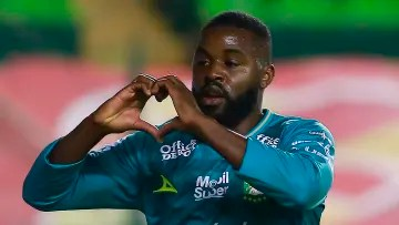 Player Joel Campbell celebrates a goal with Leon.