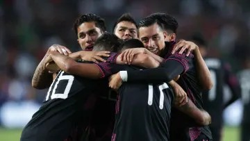 Mexico players celebrate a goal.