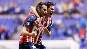 Alejandro Mayorga and Alan Torres celebrate Chivas' first goal against Puebla on Matchday 2.