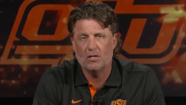 Oklahoma State head coach Mike Gundy apologized for donning an OAN t-shirt and offending his players.