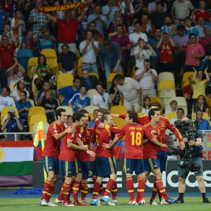 Spanish players celebrate after a goal d