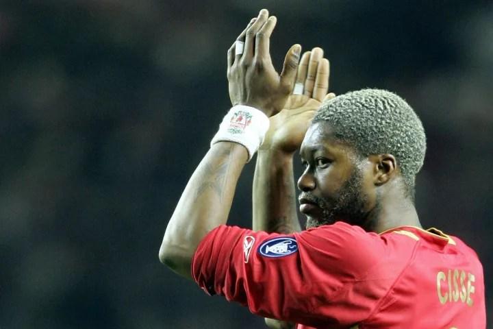 Liverpool's Djibril Cisse applauds the c