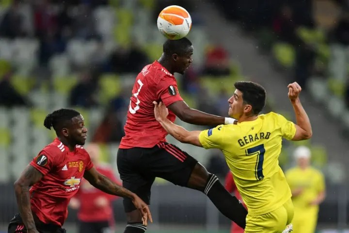 Eric Bailly challenges for a header