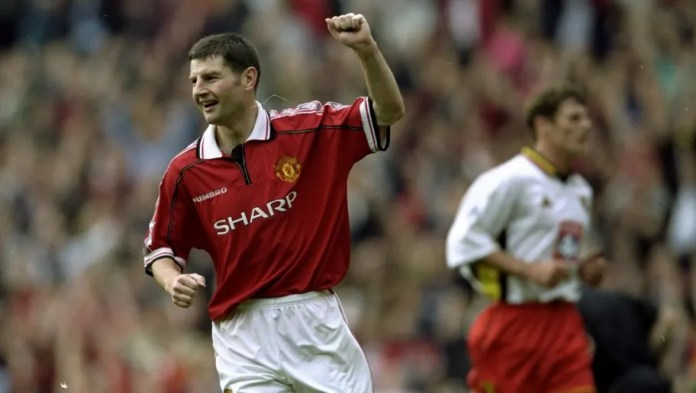 16 Oct 1999: Dennis Irwin celebrates a goal from the Penalty spot during the FA Carling Premiership game against Watford at Old Trafford in Manchester, England. United won 4 - 1.  Mandatory Credit: Clive Brunskill /Allsport