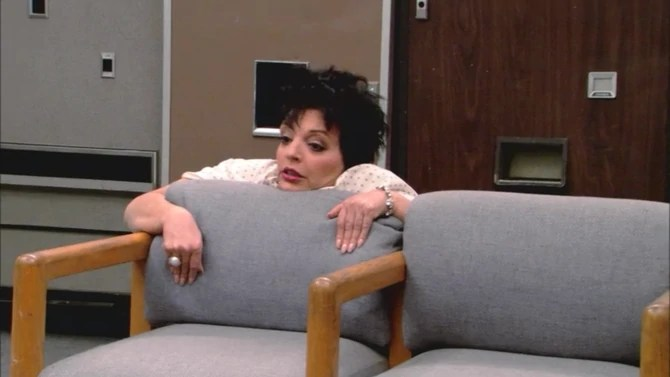 Liza Minelli as Lucille 2 gripping back of chair