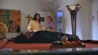 Hurley and David look at Sayid's unconscious body.