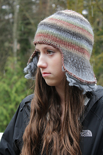 Knitted earflap hat with thrums