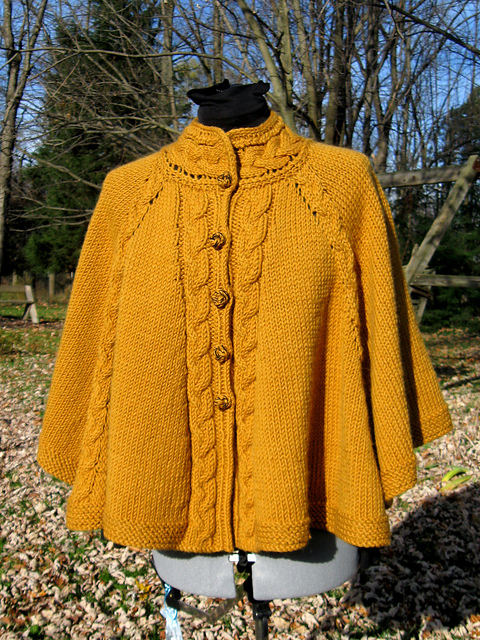 http://www.ravelry.com/patterns/library/cabled-fall-celebration-cape