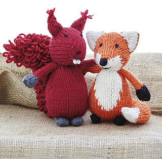 Knitted fox with squirrel friend