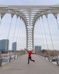 Humber Bay Arch Bridge gives some great leading lines to the happy jumping muse. Toronto, ON, Canada