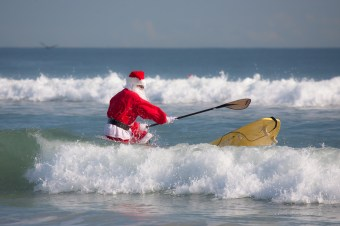 santa on a stand-up paddleboard, taken Christmas eve