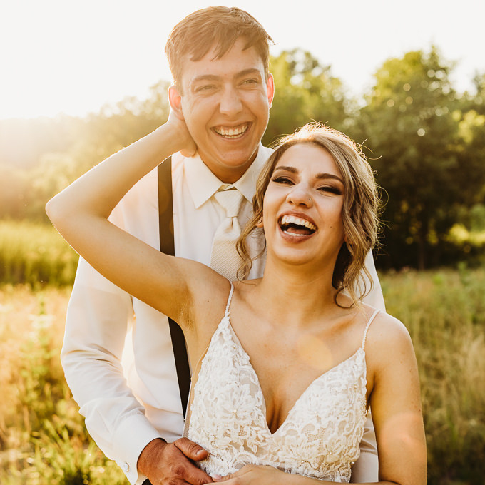 Couple laughs together, captured by Minneapolis wedding photographer Images By Nic